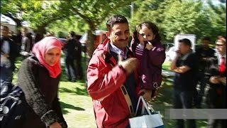 Refugees from Iraq, Syria arrive north-west of Paris