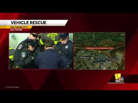 Crews rescue person trapped under vehicle in northwest Baltimore