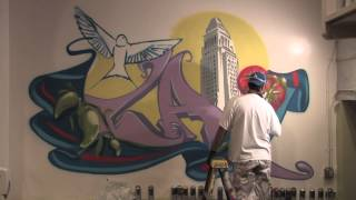 Man One paints mural at Casa La Golondrina on Olvera Street Downtown LA