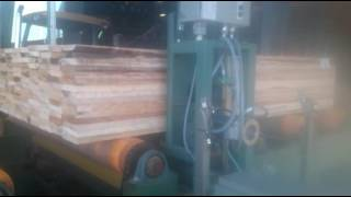 Lumber mill side seal strapping machine