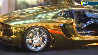 UAE Unveils World's Most Expensive Car: Gold and diamond Lamborghini goes on show in Dubai(The Lamborghini showroom in Dubai is currently home to the most expensive car in the world. The Lamborghini is made from gold, platinum and encrusted with ..., 2013-10-03T07:26:25.000Z)