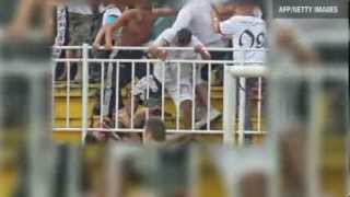 Brazil Police fire tear gas as fighting erupts in football stand