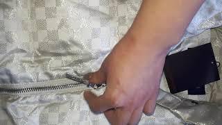 Красивый женский пуховик в стиле Louis Vuitton