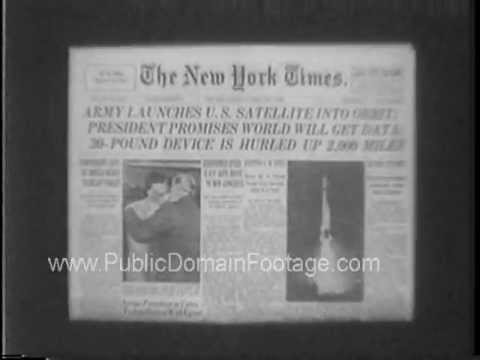 Space Race newspaper headlines on firing of satellites in the 1950's archival stock footage