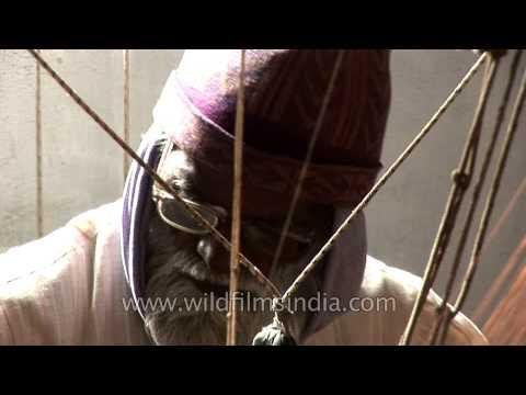 An old hand loom weaver making a Banarasi sari in Varanasi