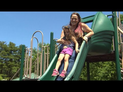 Safety Tips for Parents Riding Playground Slides With Their Kids