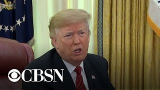 On Christmas, Trump talks shutdown, economy, Russia probe