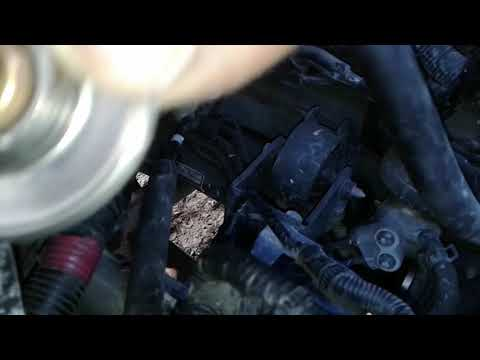 How to easily replace the thermostat and gasket on a 2009 Hyundai Tucson