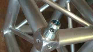 Building Global Truss Corners with the Universal Junction Block