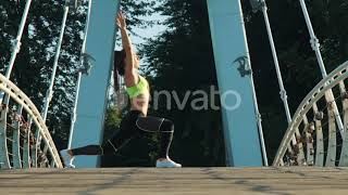 Active Woman Exercising and Stretching in City Park on Footbridge. | Stock Footage - Videohive