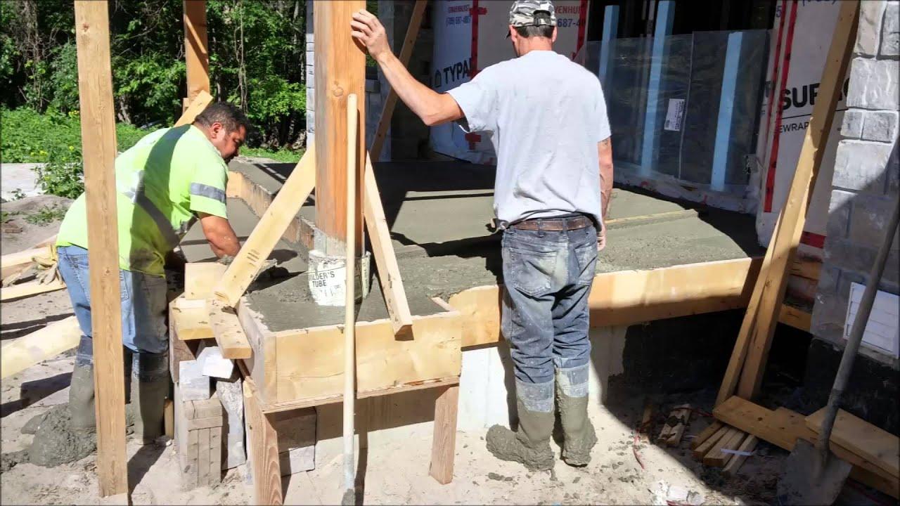 Basement garage and front porch concrete pour youtube for Pouring a basement