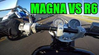 honda magna vs yamaha r6 trying to wheelie the magna