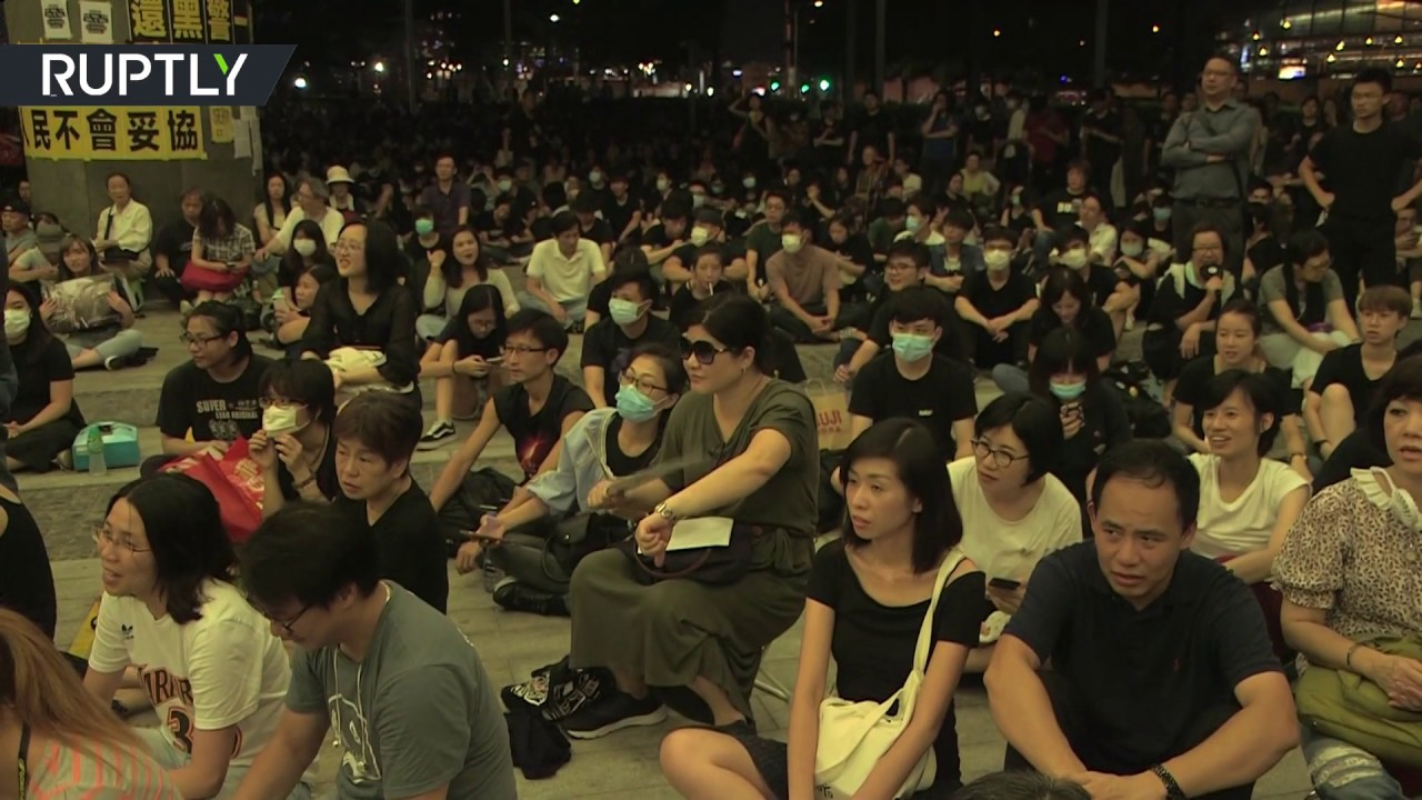 Protesters face off with police to decry pier given to People's Liberation Army in Hong Kong