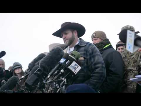 Ammon Bundy speaks to reporters at wildlife refuge headquarters