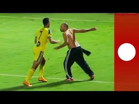 Red card! Football fan invades pitch attacking player and en