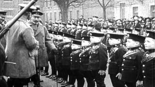 King George V and other officials review boys in formation of young boy cadets at...HD Stock Footage