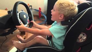 Kid Racing Playstation Dirt With Real Ferrari Steering Wheel