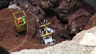 Repeat youtube video Corvette Museum Sink Hole Disaster & Recovery
