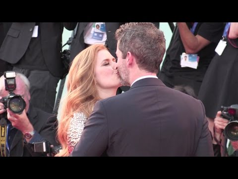 Amy Adams and her husband share some love during the Premiere of Nocturnal Animals in Venice