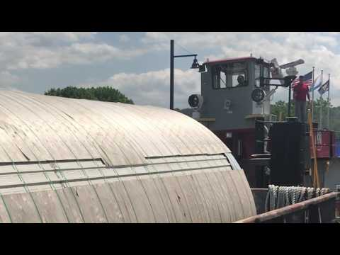 Massive Genesee Beer tanks traveling Erie Canal toward Rochester