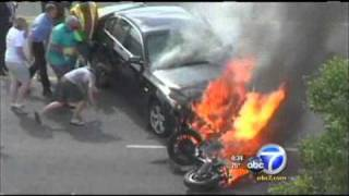 bystanders rescue man from under burning car
