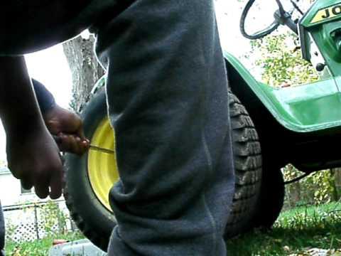 How to put a drivebelt on a john Deere 212 part 1