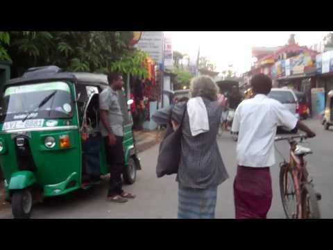 Riding scooter through Weligama, Sri Lanka