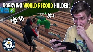 i carried a Fortnite Mobile WORLD RECORD HOLDER! (most solo wins in the world)