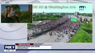 Truck drives through crowd of protesters blocking I-35W in Minneapolis