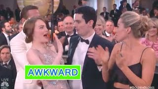 EMMA STONE'S AWKWARD HUG AT THE GOLDEN GLOBES | The Trending Show