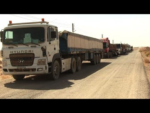 Trucks deliver first food to Syria