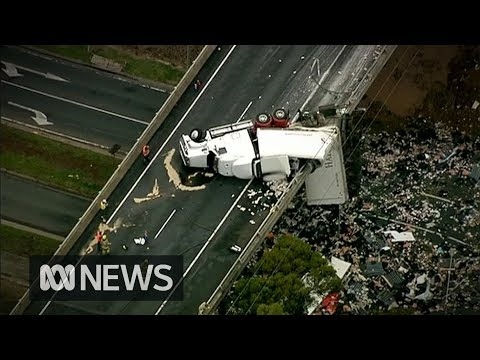 Truck carrying chicken products left dangling from overpass after crash | ABC News