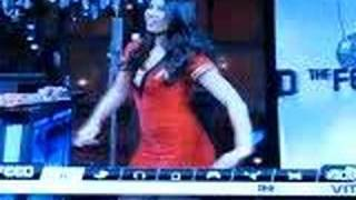 Oliva Munn in a tight red dress