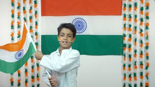Little Indian boy enthusiastically celebrating Independence Day / Republic Day - National Tri-color flag
