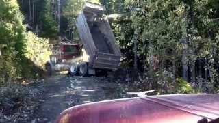 Old Peterbilt dump truck building log road.