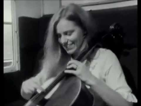 Jacqueline du Pré playing pizzicato on a train