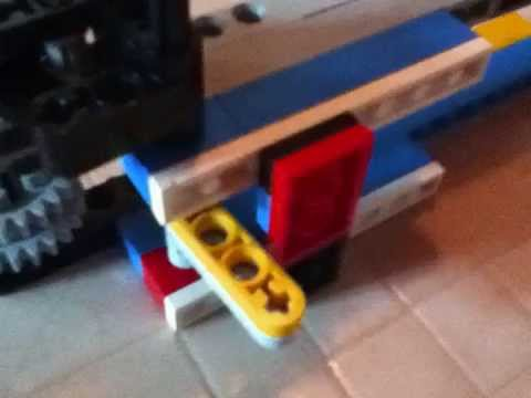 How to make a semi automatic lego gun that shoot bricks with high ...