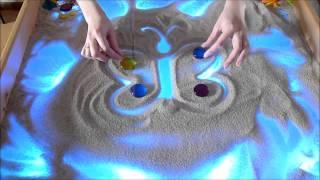 Два способа рисования бабочки на песке