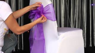 How to: various ways to tie an organza sash to a chair cover(This helpful video from Chair Cover depot (www.chaircoverdepot.co.uk) the leading name in chair cover industry shows in a simple to understand way on how to ..., 2014-01-23T17:13:47.000Z)