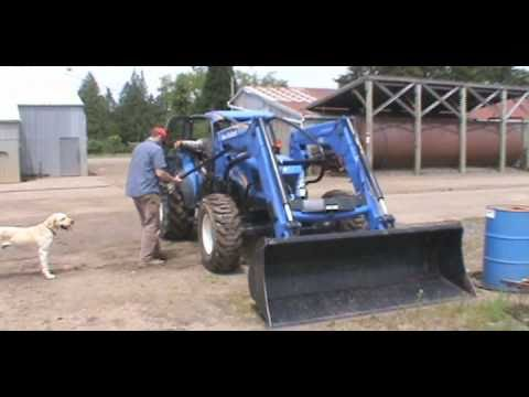 How to Change out Attachments and Loaders on a New Holland T4050 Tractor