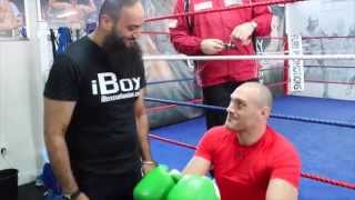 TYSON FURY IS PRESENTED WITH iBOX CUSTOM GLOVES BY COACH IMRAN WITH PETER FURY / iFL TV