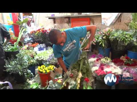 People Buying Flowers for Shavous