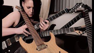 1 Girl vs. 6 Guitars