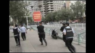 Police shot dead 2 Uyghur men in the front of running camera