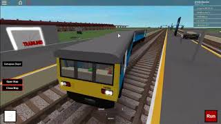 Roblox Trainlines driving a Pacer and a London Underground train.