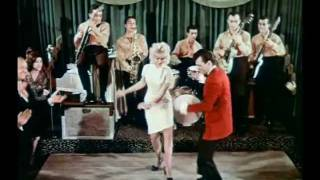 The Twist - Chubby Checker(The Twist(1960) by the great Chubby Checker. Video includes dance clips from the early 60's along with movie and television scenes., 2011-09-27T11:51:00.000Z)