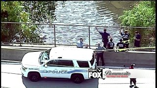 Police responding to a report of a body in Coldwater Creek in Florissant