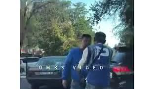 Водитель избил парковщика