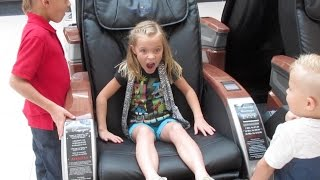 KIDS HILARIOUS REACTION TO ELECTRIC FULL BODY MASSAGE CHAIRS | DYCHES FAM