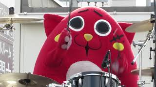 His name is Nyango Star. He is good at drums with mascot characters...